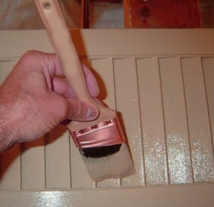 Paintbrush painting a radiator